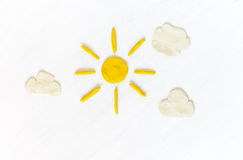 Sun and clouds on white made from plasticine Royalty Free Stock Image