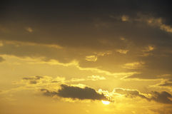Sun in Cloudy Sky Stock Image