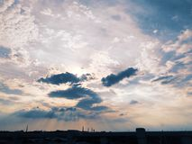 The sun comes through the clouds. In the distant skyline in north china stock images