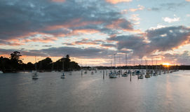 Sun comes up over a marina stock images