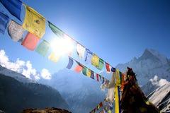 Sun coming through Annapurna base camp. Annapurna base camp prey flags nepal Royalty Free Stock Images