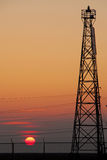 Sun by communication tower Royalty Free Stock Photo