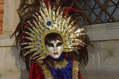 Sun costumed masked woman. At Doge's Palace  in Venice Stock Image