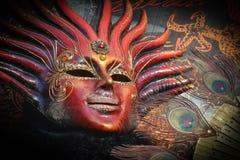 Sun costumed masked woman portrait. Blue costumed masked woman portrait  in Venice Stock Images