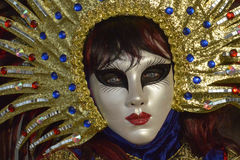 Sun costumed masked woman portrait. In Venice Stock Photography