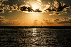 Sun Covered With Clouds Above Sea Royalty Free Stock Images