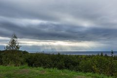 Sun cracking through some heavy clouds. Over lake royalty free stock images