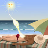 Sun creates tan for woman who lies on the beach. Sun draws suntan Royalty Free Stock Photo