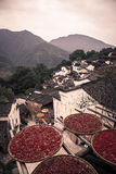 Sun Crops on old Chinese roofs in rural China Stock Images