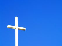 Sun Cross. A cross against a flawless sky Royalty Free Stock Photos