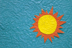 Sun on crumpled paper Royalty Free Stock Photo