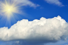 Sun and cumulus clouds Royalty Free Stock Images