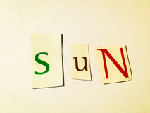 Sun - Cutout Words Collage Of Mixed Magazine Letters with White Background. Caption composed with letters torn from magazines with White Background Royalty Free Stock Image