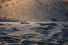 Sun dans la texture de sable Photo libre de droits