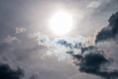 Sun in the dark clouds. Sun in the dark clouds, grey dramatic sky, rain storm background royalty free stock photo