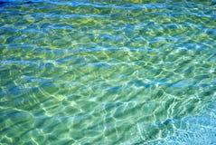 The Sun dat in het water wordt weerspiegeld Stock Afbeelding