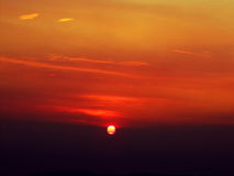 Sun dawn, the solar disk. background. Very beautiful sun dawn, the solar disk seen against the background of multi-colored sky, the sun disc is out of a huge Stock Images