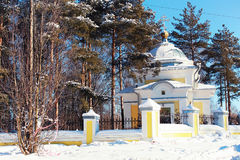 Sun day church in the winter forest Stock Photography