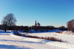 Sun day church in the winter forest Royalty Free Stock Photography