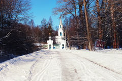 Sun day church in the winter forest Royalty Free Stock Image