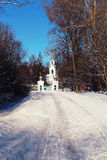 Sun day church in the winter forest. Large suburban landscape of the park on a sunny winter day Royalty Free Stock Photography