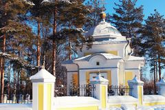 Sun day church in the winter forest. Various objects of the winter season in the best of this wonderful period Royalty Free Stock Photography