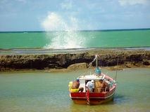 A sun day to fish. Arembepe beach, Brazil royalty free stock images
