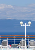 Sun deck on cruise ship. Cruise ship sun deck with mountains in the background Royalty Free Stock Photo