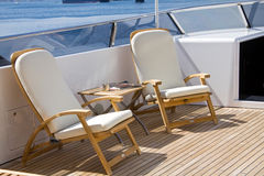 Sun on deck. Sun lounge chairs on boat deck Royalty Free Stock Image