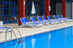Sun deck pool. Deck chairs at sundeck and swimming pool stock photography