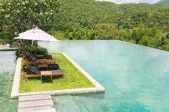 Sun deck , swimming pool. And mountain range Royalty Free Stock Image