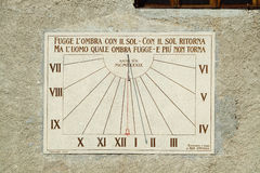 Sun dial. A sun dial on the wall ogf a church in Italy Stock Photography