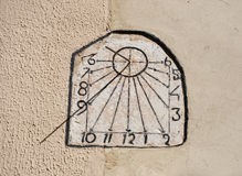 Sun Dial Clock on Cement Wall Stock Photography