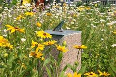 Sun Dial Garden. A bronze sundial in the garden royalty free stock photography
