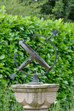 Sun dial with hedge Stock Photos
