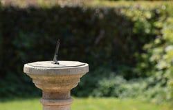 Sun dial in a Summer garden royalty free stock image