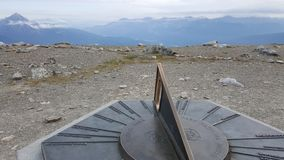 Sun Dial on Top of the World. Mountain stock images