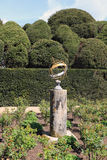 Sun dial and topiary hedge Stock Images