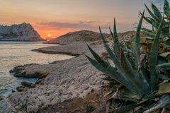 Sunset in Les Goudes, close to Marseille. Sun disappearing between two mountains in Les Goudes Royalty Free Stock Image
