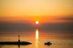 Sun disk reflecting on sea surface Stock Images