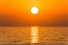 Dawn in Florida. Sun disk with reflection in the ocean at sunrise in Florida, Aventura Beach stock photo
