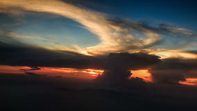 Sun Disk on Skyline above Clouds out of Airliner at Sunset. Bright sun disk on skyline above orange clouds out of airliner window at sunset stock footage