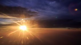 Sun Disk on Skyline above Clouds out of Airliner at Sunset. Bright sun disk on skyline above orange clouds out of airliner window at sunset stock video footage
