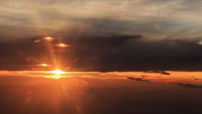 Sun Disk on Skyline above Clouds out of Airliner at Sunset. Bright sun disk on skyline above orange clouds out of airliner window at sunset stock video