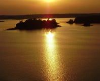 Sun dourado, céu e mar Foto de Stock Royalty Free