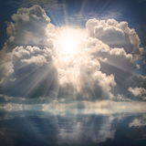 The sun on dramatic sky over sea. Natural background. Forces of nature concept stock photos