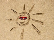 Sun drawing on the sand Royalty Free Stock Photography