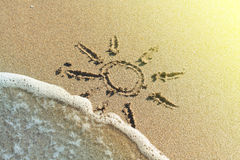 Sun drawing on the sand Stock Photography