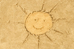 Sun drawing in sand Stock Photo