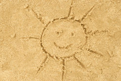 Sun drawing in sand Stock Image